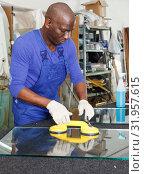 Купить «Man working in glass workshop», фото № 31957615, снято 16 мая 2018 г. (c) Яков Филимонов / Фотобанк Лори