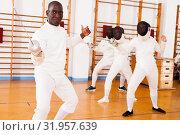 Купить «Sporty african american man fencer practicing effective fencing techniques», фото № 31957639, снято 11 июля 2018 г. (c) Яков Филимонов / Фотобанк Лори