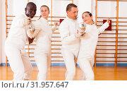 Купить «Men and women fencers posing with foils together at fencing workout», фото № 31957647, снято 11 июля 2018 г. (c) Яков Филимонов / Фотобанк Лори