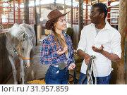 Купить «Portrait of couple of horse farm workers», фото № 31957859, снято 2 октября 2018 г. (c) Яков Филимонов / Фотобанк Лори