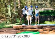 Купить «Team of friends overcomes an obstacle course in an amusement park», фото № 31957983, снято 25 августа 2019 г. (c) Яков Филимонов / Фотобанк Лори