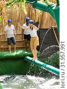 Купить «Youth in the amusement park trying to pass through an obstacle course», фото № 31957991, снято 25 августа 2019 г. (c) Яков Филимонов / Фотобанк Лори