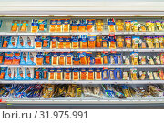 Купить «Russia, Samara, May 2019.: Packages with salted smoked fish on a shelf in a supermarket. Text in Russian: discounts», фото № 31975991, снято 5 мая 2019 г. (c) Акиньшин Владимир / Фотобанк Лори