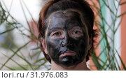 Female face covered with a black mask. Стоковое видео, видеограф Константин Мерцалов / Фотобанк Лори