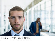 Купить «Businessmen standing in the lobby of a modern business building», фото № 31983835, снято 21 марта 2019 г. (c) Wavebreak Media / Фотобанк Лори