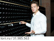 Купить «Male worker checking secondary fermentation of wine», фото № 31985563, снято 10 ноября 2016 г. (c) Яков Филимонов / Фотобанк Лори