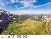 Aerial top view from drone to wonderful alpine landscape and meadows at Pass Gardena with majestic Sella mountain group in Dolomiti. Alps, South Tirol, Dolomites mountains, passo di Val Gardena, Italy. Редакционное фото, фотограф Алексей Ширманов / Фотобанк Лори