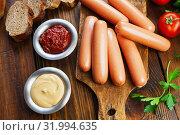 Купить «Fresh raw sausage», фото № 31994635, снято 15 апреля 2019 г. (c) Надежда Мишкова / Фотобанк Лори