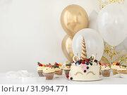 Купить «Close up of little girl's birthday party table with unicorn cake», фото № 31994771, снято 19 июля 2019 г. (c) Ekaterina Demidova / Фотобанк Лори