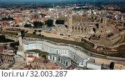 Купить «Panoramic view from drone of Catalan city of Lleida with medieval Cathedral of St. Mary of La Seu Vella», видеоролик № 32003287, снято 25 июля 2018 г. (c) Яков Филимонов / Фотобанк Лори