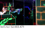 Купить «Men and women in business suits playing laser tag emotionally in dark room», видеоролик № 32003471, снято 20 августа 2019 г. (c) Яков Филимонов / Фотобанк Лори