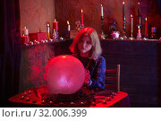 young woman fortune teller with illuminated crystal ball. Стоковое фото, фотограф Майя Крученкова / Фотобанк Лори