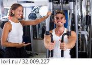 Man using pec deck gym machinery. Стоковое фото, фотограф Яков Филимонов / Фотобанк Лори