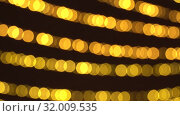 Купить «Bokeh of blurred New Year's flickering garlands and flashes. Christmas background of warm golden lights. 4K Ultra HD», видеоролик № 32009535, снято 19 августа 2019 г. (c) Dmitry Domashenko / Фотобанк Лори
