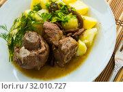 Купить «Prepared with mushrooms and potatoes tasty lamb served with greens», фото № 32010727, снято 18 января 2020 г. (c) Яков Филимонов / Фотобанк Лори