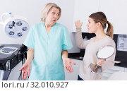 Woman conflicting with cosmetologist. Стоковое фото, фотограф Яков Филимонов / Фотобанк Лори