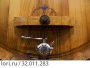 Купить «Винная бочка с металлическим краном в старом винном погребе», фото № 32011283, снято 13 мая 2014 г. (c) Наталья Волкова / Фотобанк Лори