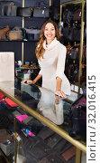 Купить «Portrait of woman selling wallets and purses», фото № 32016415, снято 27 января 2020 г. (c) Яков Филимонов / Фотобанк Лори