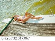Купить «Young beautiful slim sexy girl in bikini and pareo is resting on cruise on a private sailing yacht», фото № 32017067, снято 25 июля 2017 г. (c) katalinks / Фотобанк Лори