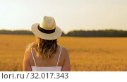 Купить «woman in straw hat on cereal field in summer», видеоролик № 32017343, снято 4 августа 2019 г. (c) Syda Productions / Фотобанк Лори