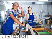 Foreman is ready to work on circular saw in assembly shop. Стоковое фото, фотограф Яков Филимонов / Фотобанк Лори