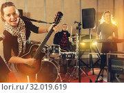Young girl guitar player and singer with band. Стоковое фото, фотограф Яков Филимонов / Фотобанк Лори