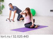 Купить «Young woman feeling bad during training in first aid concept», фото № 32020443, снято 10 мая 2019 г. (c) Elnur / Фотобанк Лори