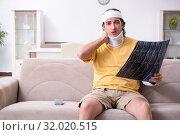 Купить «Young man after accident recovering at home», фото № 32020515, снято 3 мая 2019 г. (c) Elnur / Фотобанк Лори
