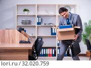 Купить «Young male employee being fired from his work», фото № 32020759, снято 17 апреля 2019 г. (c) Elnur / Фотобанк Лори