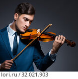 Купить «Young man playing violin in dark room», фото № 32021903, снято 14 августа 2017 г. (c) Elnur / Фотобанк Лори