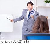 Купить «Business presentation in the office with man and woman», фото № 32021915, снято 7 августа 2017 г. (c) Elnur / Фотобанк Лори