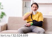 Купить «Young man after car accident suffering at home», фото № 32024699, снято 21 февраля 2019 г. (c) Elnur / Фотобанк Лори