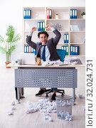 Купить «Businessman rejecting new ideas with lots of papers», фото № 32024731, снято 18 февраля 2019 г. (c) Elnur / Фотобанк Лори