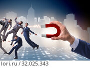 Businessman in recruitment concept with horseshoe magnet. Стоковое фото, фотограф Elnur / Фотобанк Лори