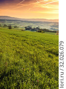 Купить «Pasture on the background of Alps in Switzerland at sunrise. Swiss small village at the foot of mountains surrounded by meadows in the morning mist», фото № 32026079, снято 4 апреля 2020 г. (c) easy Fotostock / Фотобанк Лори