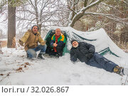 company of mature tourists in a snowy forest near a tent. Стоковое фото, фотограф Акиньшин Владимир / Фотобанк Лори