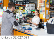 Купить «Woman seller standing at the counter and consulting male», фото № 32027091, снято 17 мая 2018 г. (c) Яков Филимонов / Фотобанк Лори