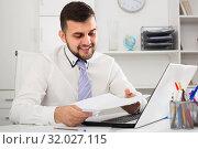 Купить «Guy is signing agreement papers», фото № 32027115, снято 5 марта 2017 г. (c) Яков Филимонов / Фотобанк Лори