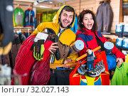 Купить «Young couple demonstrating tourist equipment», фото № 32027143, снято 8 марта 2017 г. (c) Яков Филимонов / Фотобанк Лори