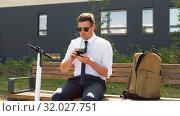 Купить «businessman with smartphone drinking smoothie», видеоролик № 32027751, снято 5 августа 2019 г. (c) Syda Productions / Фотобанк Лори
