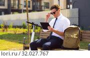 Купить «businessman with tablet computer, bag and scooter», видеоролик № 32027767, снято 5 августа 2019 г. (c) Syda Productions / Фотобанк Лори