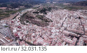 Купить «Aerial view of Sagunto city and antique roman fortress, Valencia, Spain», видеоролик № 32031135, снято 19 марта 2019 г. (c) Яков Филимонов / Фотобанк Лори