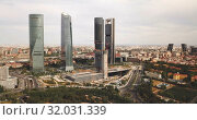 Купить «Aerial view of four Towers Business Area (Cuatro Torres) in Madrid, Spain», видеоролик № 32031339, снято 16 июня 2019 г. (c) Яков Филимонов / Фотобанк Лори