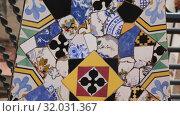 Купить «Magical rooftop of Palau Guell with chimneys and central spire designed by architect Antoni Gaudi», видеоролик № 32031367, снято 2 сентября 2018 г. (c) Яков Филимонов / Фотобанк Лори