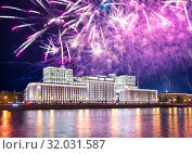 Main Building of the Ministry of Defence of the Russian Federation-- is the governing body of the Russian Armed Forces and celebratory colorful fireworks exploding in the skies. Moscow, Russia (2019 год). Стоковое фото, фотограф Владимир Журавлев / Фотобанк Лори