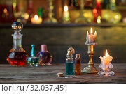 Купить «magic potions in bottles on wooden table», фото № 32037451, снято 14 августа 2019 г. (c) Майя Крученкова / Фотобанк Лори