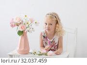 Купить «beautiful little blonde girls with flowers on white background», фото № 32037459, снято 15 августа 2019 г. (c) Майя Крученкова / Фотобанк Лори