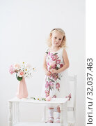 Купить «beautiful little blonde girls with flowers on white background», фото № 32037463, снято 15 августа 2019 г. (c) Майя Крученкова / Фотобанк Лори