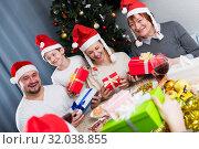 Купить «Happy family with Christmas gifts», фото № 32038855, снято 17 декабря 2017 г. (c) Яков Филимонов / Фотобанк Лори