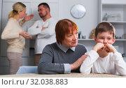 Купить «Grandma hugging upset boy during parental quarrel», фото № 32038883, снято 17 декабря 2017 г. (c) Яков Филимонов / Фотобанк Лори